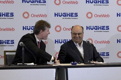 At the Satellite 2021 event in National Harbor, Maryland, OneWeb CEO Neil Masterson (left) and Hughes Network Systems CEO Pradman Kaul (right) announce the companies have signed agreements for Hughes to become a distribution partner for OneWeb service.