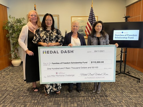 Rhianna Quinn Roddy, Executive Director of the Families of Freedom Scholarship Fund, along with scholarship recipient Dening Wu-Lohez, and mother of three scholarship recipients Kathy Wisniewski, accept a $115,000 donation from Tina Lee, Chair of Scholarship America, on behalf of Medal Dash for the Families of Freedom Scholarship Fund's 3,000 Reasons to Give campaign kickoff event on Thursday, September 9, 2021.
