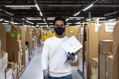 Amazon Process Assistant Mohammed Hanif is photographed at YYC1 in Calgary, Alberta (CNW Group/Amazon Canada)