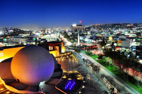 A nighttime view of Tijuana from above the Tijuana Cultural Center (CECUT) in the Zona Río district of Tijuana, Mexico. Together with San Diego, California, the two cities have partnered in an innovative cross-border bid for the 2024 World Design Capital designation.