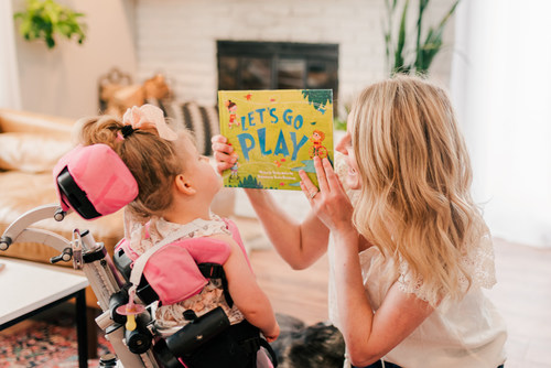 Mariah Gillaspie, the Founder and CEO of the Lightning and Love Foundation, reads a book to her daughter Emma who is affected by THAP12 epileptic encephalopathy.