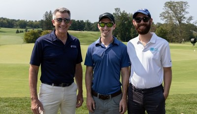 PenFed Foundation President and retired U.S. Army Gen. John W. Nicholson, Jr. (left) joins golfers at the 18th Annual Military Heroes Golf Classic