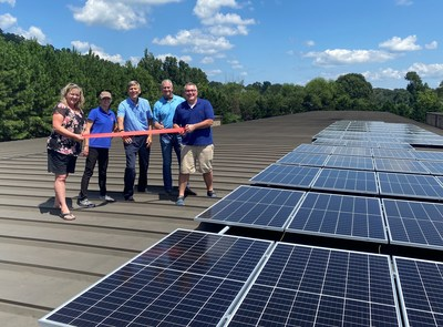 Kelly Epps, David Protiva, Mark Titshaw, Chris Stewart with Kathy Henderson atop a building for the ribbon cutting.