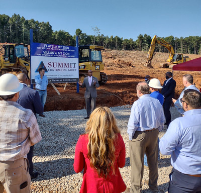 Jeff Turner, Chair of the Clayton County Board of Commissioners, speaks to the crowd gathered for the Mt. Zion groundbreaking. At left, front, is Tab Bullard, Zimmerman Properties.