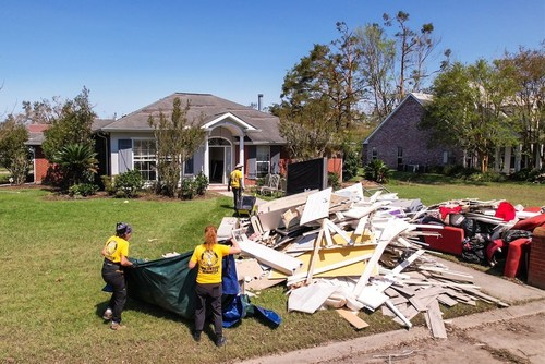 The Volunteer Ministers carried out all the mold-ridden items—the first step to salvaging the flooded home.