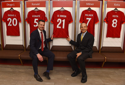 Anfield Stadium, Liverpool, 16 September 2021: [Pictured L-R] Liverpool Football Club CEO, Billy Hogan, presents SC Johnson Chairman and CEO, Fisk Johnson, with a branded LFC shirt to mark the launch of their new global sustainability partnership, Goals for Change. The partnership kicks off with a closed loop recycling model which aims to repurpose more than 500,000 plastic bottles used at Anfield each season.