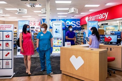 CVS Pharmacy HealthHUB team interacts with a customer