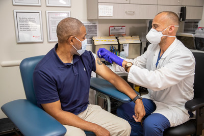 CVS Health MinuteClinic nurse administers a flu shot to a patient.