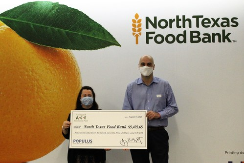 ACE Cash Express associate presents a $5,475 donation to Zahra Perez, Major Gift Officer at the North Texas Food Bank