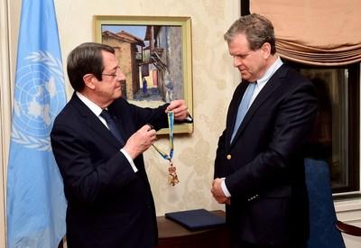 Cyprus President Nicos Anastasiades presents one of his country's most prestigious awards to AJC CEO David Harris. Photo by Dimitrios Panagos (PRNewsfoto/American Jewish Committee)