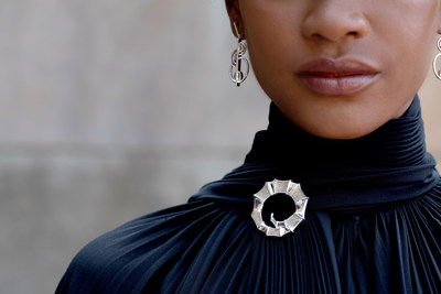 Model Sosheba in the BREEDLOVE Brooch and the LOVE22 Earrings in Sterling Silver from the Dune Jewelry x Dy'amond Breedlove Collaboration. Photo credit: Samantha Robshaw Photography.