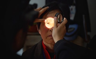 Screening for diabetic retinopathy takes places at a hospital in Jinan, China. Photo by Geoff Oliver Bugbee