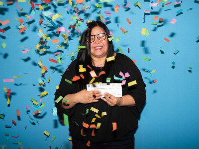 A Montréal woman splits the Lotto 6/49 jackpot of $10,990,458 with her group (CNW Group/Loto-Québec)