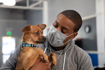 Actor and comedian Kenan Thompson snuggles a rescue pup at Banfield Pet Hospital's NextVet internship launch event at the Boys & Girls Club in Whittier, Calif.