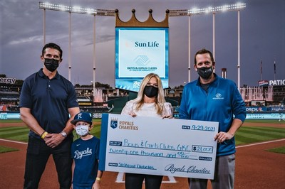 (From left to right): Lance Kappelman, Sun Life; son Voss; Amanda Grosdidier, Royals Charities; Jason Roth, Boys and Girls Clubs of Greater Kansas City