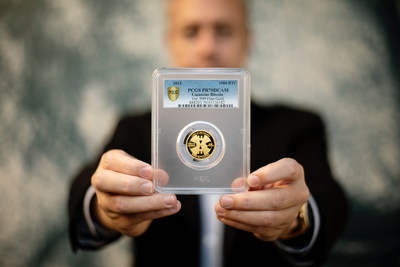 """Ian Russell, president of GreatCollections in Irvine, California, holds the world's most valuable numismatic item, the 1,000 Bitcoins denomination """"Gold Cas"""" worth $48 million. (Photo courtesy of GreatCollections.)"""