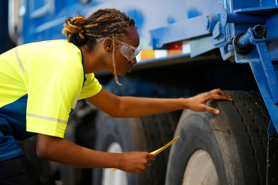 A student works on a collection vehicle at the Republic Services Technical Institute in Dallas, Texas, on Monday, Oct. 4, 2021.