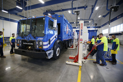 Students work on a collection vehicle at the Republic Services Technical Institute in Dallas, Texas, on Monday, Oct. 4, 2021.