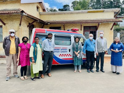 Kalpana Kar (extreme right) of Microland Foundation handing over the ambulance to Dr Tony Abraham Thomas, Neurosurgeon and Medical Superintendent, Kotagiri Medical Fellowship Hospital (fourth from left). Also in the picture are Dr V Srinivas (extreme left) and Mr Dilip Rane (second from right) with community volunteers supporting KMF and visiting doctors from Christian Medical College, Vellore.