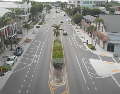 The reinvented Wilton Drive protects bicyclists and pedestrians with dedicated bike lanes, wider sidewalks and a median serving as a haven of safety for pedestrians crossing the busy street.