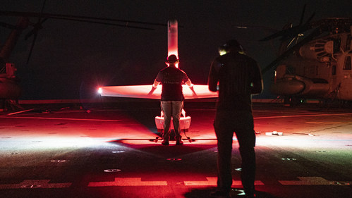 Operators supporting the 11th Marine Expeditionary Unit prepare to launch a V-BAT UAS aboard amphibious USS Portland (LPD 27). Photo by Sgt. Alexis Flores, USMC.