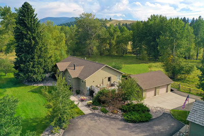 A charming, 3,800-sf residence with 4 beds and 4 baths is situated near the entry to the ranch. There are also several modest outbuildings near the home, including a barn, hay shed, feed lot and corral pen. MontanaLuxuryAuction.com.