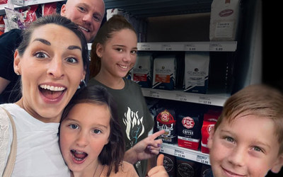 Fire Department Coffee CEO, Luke Schneider, and his family at their local Meijer store