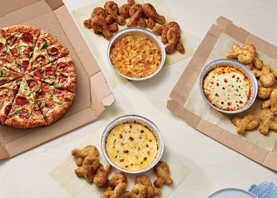 Domino's newest side item, Oven-Baked Dips, pair perfectly with Bread Twists. Customers can choose from Baked Apple, Five Cheese and Cheesy Marinara Dip.