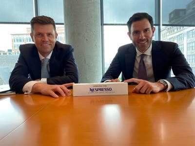 Guillaume Le Cunff, CEO of Nestle Nespresso SA and Jonathan Fantini Porter, Co-Founder and Executive Director of the Partnership for Central America with the first ever box of Nespresso coffee from Honduras