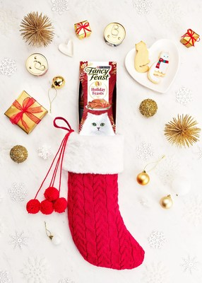 The new Fancy Feast Stocking Stuffer Sleeve features two new holiday feast inspired flavors, Yuletide Turkey Feast with Sweet Potato & Tomato in Gravy and Hearthside Salmon Platter with Pumpkin & Spinach Pate