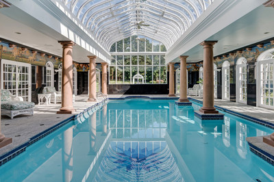 The estate's indoor pool features a Machin Conservatory glass ceiling (made popular in the U.K.) that was custom-made by artisans in North Carolina. A large hot tub is adjacent to the pool, in addition to ample deck space. NewHampshireLuxuryAuction.com.