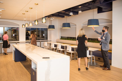 Reception attendees exploring 3rd floor lunch room and cafeteria at USSFCU's new Bertie H. Bowman headquarters building