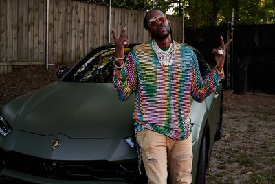 2 Chainz with a Lamborghini Urus booked on Turo