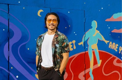 Artist Kent Yoshimura pictured in front of the mural at 6 Rose Avenue in Los Angeles' Venice neighborhood.