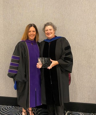 Beverly Meyers, JD (right), a recipient of the 2021 Northcentral University Academic Excellence Delphi Award, stands with Lisa Hutton, JD, dean of the university's John F. Kennedy School of Law after receiving her award.