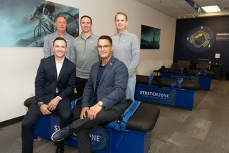 Former NFL Quarterback Drew Brees with Stretch Zone's executive and New Orleans teams.