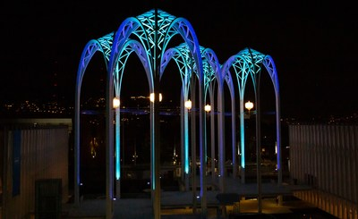The arches at Pacific Science Center in Seattle are lit with the colors of the city's new hockey team, the Seattle Kraken. (Pacific Science Center Photo)
