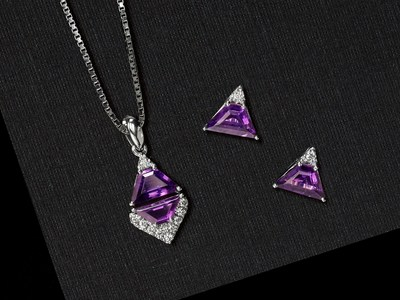 Geometric gemstone earrings and pendants are on-trend for the holidays.