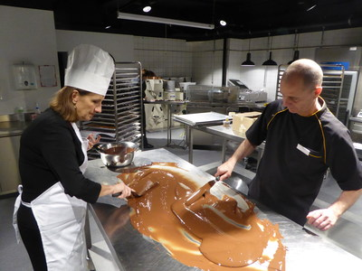 Tour de Chocolat participant works with chocolatier Blaise Poyet at Laderach studios in Vevey Switzerland
