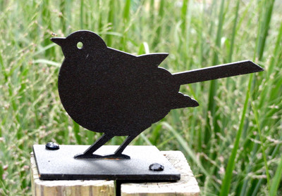 A garden bird sculpture from Minnie and Moon looks great anywhere in the yard. Nine different birds are available, and each steel sculpture will last for years.