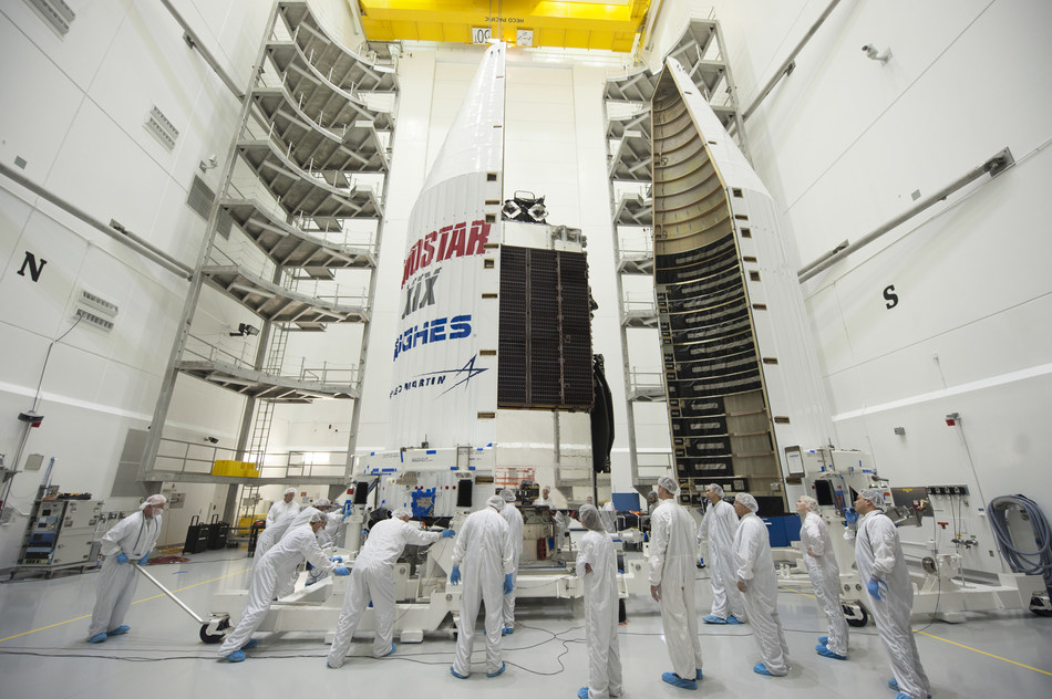 The EchoStar XIX satellite is enclosed in the four-meter fairing that is then placed atop an Atlas V 431 rocket. Photo courtesy of Lockheed Martin and United Launch Alliance.
