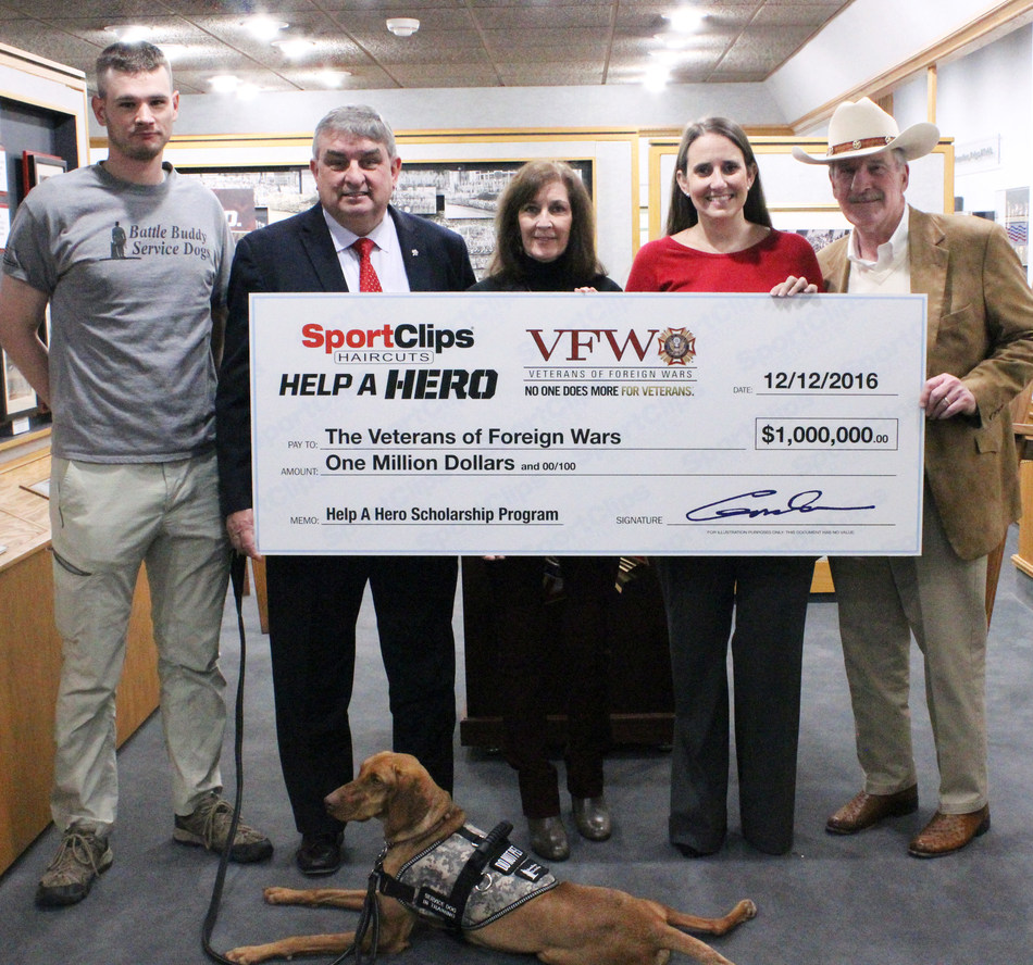 Sport Clips Haircuts donates record $1 Million to **VFW Help A Hero Scholarship Program. (L to R) Jeffrey Martin, Help A Hero Scholarship recipient; Brian Duffy, VFW National Commander; Martha England, Sport Clips Haircuts VP of Marketing; Amanda Palm, Sport Clips Haircuts Corporate Communications manager; Gordon Logan, founder and CEO of Sport Clips Haircuts.