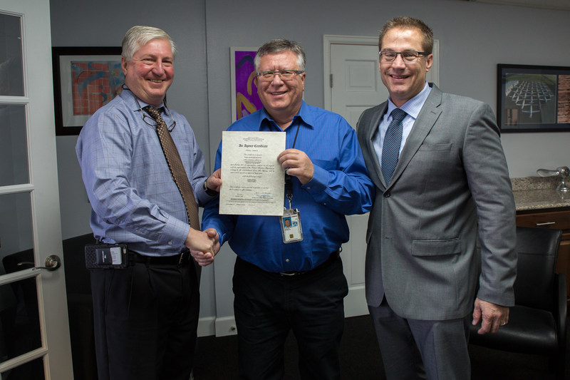 Tempus Jets CEO, Jack Gulbin, and Randy Brooks, VP of Maintenance and Technical Services, accept Part 145 Repair Station Certification from the Federal Aviation Administration (FAA)