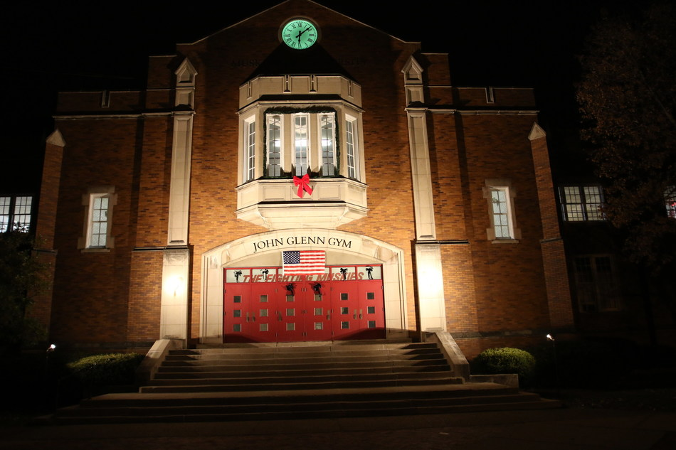 "NEW CONCORD, OH -- John Glenn Gymnasium, named in 1962 to honor Muskingum University's distinguished alumnus and trustee, is lighted in tribute throughout the rest of December. The New Concord, Ohio, campus was the site last Thursday of ""A Call to Service: A Remembrance,"" which commemorated a pivotal day, December 7, 1941, in the lives of John Glenn and his wife, Annie Castor. That day, the young couple decided that Glenn would leave college and join the Marines and a life of public service."