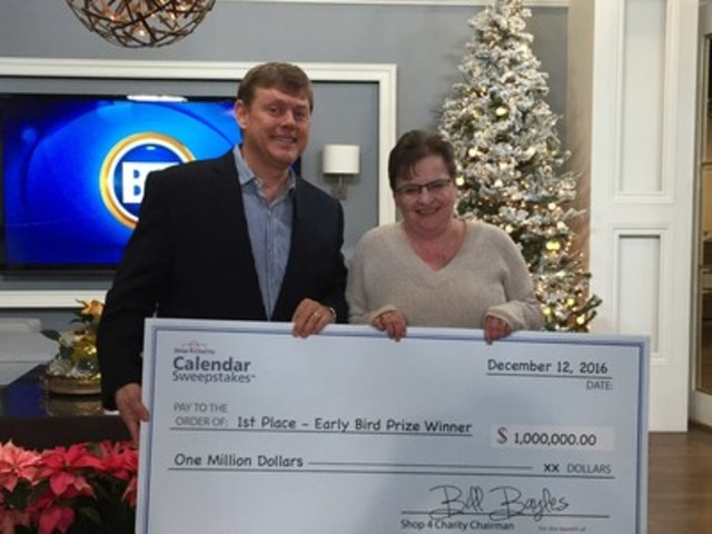 Shari Laubenstein of Calgary, with Shop4Charity Chairman Bill Bayles, is the $1 million Early Bird Winner in Shop4Charity's Calendar Sweepstakes in support of the Canadian Breast Cancer Foundation. Shari was inspired to buy Shop4Charity's Calendar because a good friend was recently diagnosed with breast cancer. (CNW Group/Shop4Charity)