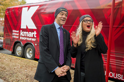 Richard Shadyac Jr., President and CEO of ALSAC, the fundraising and awareness organization for St. Jude Children's Research Hospital and Kelly Cook, CMO for Kmart, celebrate near Kmart's newly unveiled V.E.R.V. VR experience.