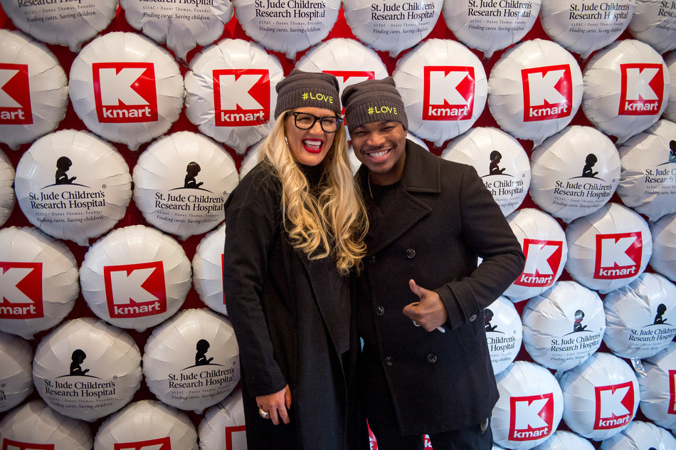 Kelly Cook, CMO for Kmart, and superstar NE-YO, celebrate at St. Jude Children's Research Hospital that the retailer raised more than $100 million in lifetime donations.