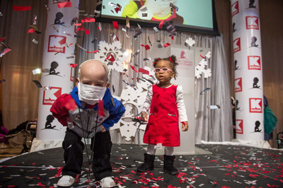 Patients Isaac and Elaina dance as they join St. Jude Children's Research Hospital and Kmart, to celebrate the retailer raising more than $100 million in donations.