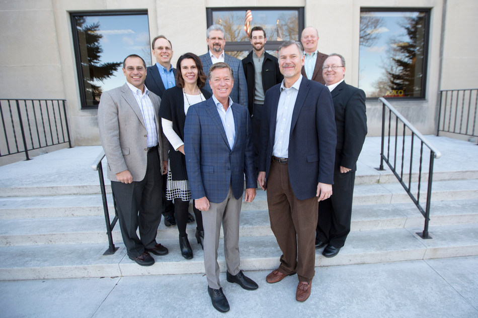 AZCO President and CEO, John Trottier and Burns & McDonnell CEO-Elect, Ray Kowalik and team gather outside AZCO INC. in Appleton, Wisconsin after finalizing the Burns & McDonnell Inc. acquisition of AZCO INC. on December 9, 2016.