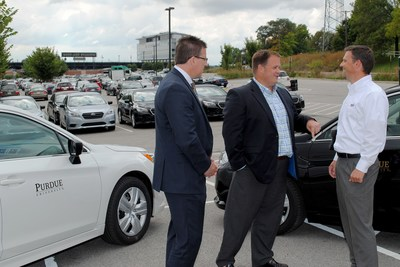 Paul Evon of Enterprise, Rob Wynkoop of Purdue and Brad Rhorer of Subaru of Indiana discuss the first delivery of cars to Purdue as part of a new lease program through Enterprise. (Purdue University photo)